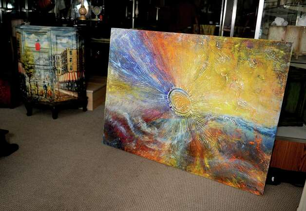 Artwork is displayed at U & I Deco in Stamford on Tuesday, July 24, 2012. Photo: Lindsay Niegelberg / Stamford Advocate
