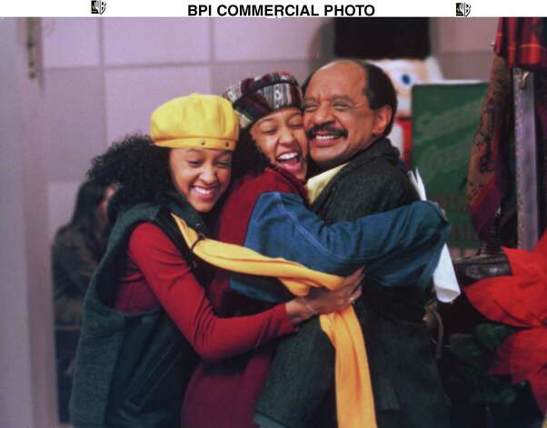 Sherman Hemsley guest stars as Grandpa Campbell. who brings his own unique brand of joy to the holiday season in the 'Sister, Sister' episode titled 'Christmas' airing Wednesday. December 13 (8:00-8:30 PM ET/PT) on The WB. (Pictured left to right are Tia and Tamera Mowry and Sherman Hemsley.) Contact: Jane Covner 818-977-6009. BPI DIGITAL PHOTO  THE WB Photo: BPI / THE WB