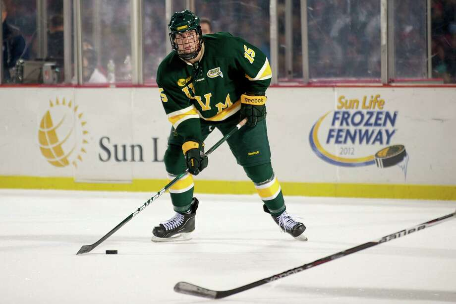 Westport's Mike Paliotta of the University of Vermont surveys his options during a January game against the University of Massachusetts outdoors at Fenway Park in Boston. Paliotta has been invited to try out for the U.S. Junior National Team and leaves next week for its Lake Placid training camp. Photo: Contributed Photo, Brian Jenkins Contributed Photo / Westport News