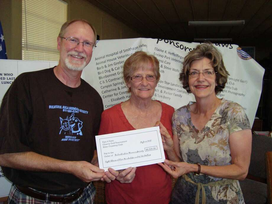 President of BAHS Richard Lindell and Vice President Linda Binkley present a check for $8,506 to Carrye Franzel, the event coordinator. Photo: Courtesy Photo