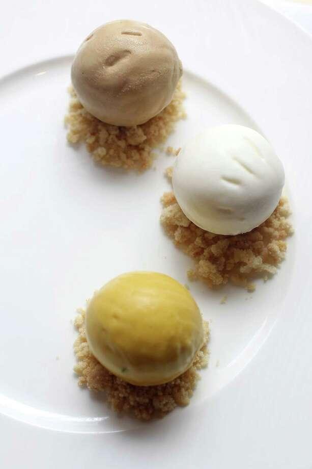 Cloud 10 Creamery's Chris Leung created ice cream flavors (top to bottom) Vietnamese coffee, sesame oil and mango/cilantro. Photo: Karen Warren / © 2012  Houston Chronicle