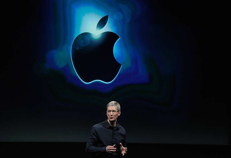 FILE – JULY 24:  Apple reported strong earnings for the third quarter with revenue of $35 billion, a jump of 23% compared to last year, but missed Wall Street's expectations with unexpected lower sales of the iPhone.    CUPERTINO, CA - OCTOBER 04:  Apple CEO Tim Cook speaks at the event introducing the new  iPhone 4s at the company's headquarters October 4, 2011 in Cupertino, California.    The announcement marks the first time Cook introduces a new product since Apple co-founder Steve Jobs resigned in August.  October 4, 2011 in Cupertino, California.  (Photo by Kevork Djansezian/Getty Images) Photo: Kevork Djansezian, Getty Images