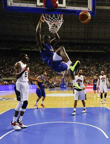 BARCELONA, SPAIN - JULY 24:  Serge Ibaka #14 of the Spain Men's Senior National Team dunks the ball during a Pre-Olympic Men's Exhibition Game between USA and Spain at Palau Sant Jordi on July 24, 2012 in Barcelona, Spain. Photo: David Ramos, Getty Images / 2012 Getty Images