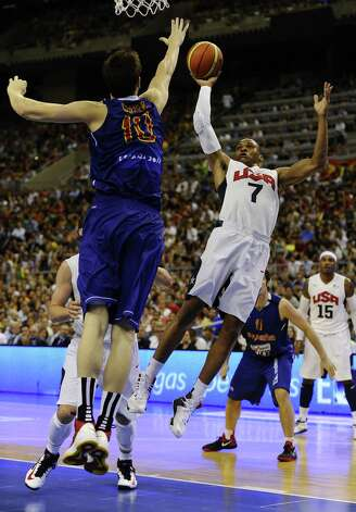 BARCELONA, SPAIN - JULY 24:  Russell Westbrook #7 of the US Men's Senior National Team shoots against Victor Claver #10 of the Spain Men's Senior National Team during a Pre-Olympic Men's Exhibition Game between USA and Spain at Palau Sant Jordi on July 24, 2012 in Barcelona, Spain. Photo: David Ramos, Getty Images / 2012 Getty Images