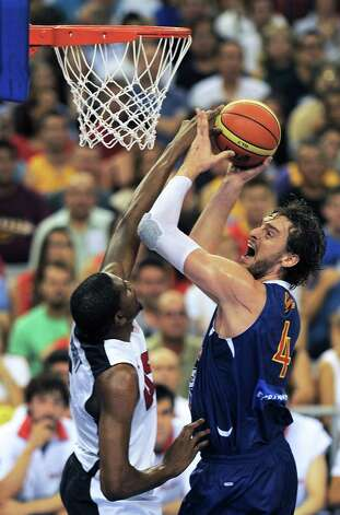 Spain's Pau Gasol (R) vies with Kevin Durant (L) during the Pre-Olympic friendly basketball match between Spain and USA at Palau Sant Jordi in Barcelona on July 24, 2012.  AFP PHOTO / LLUIS GENELLUIS GENE/AFP/GettyImages Photo: LLUIS GENE, AFP/Getty Images / AFP