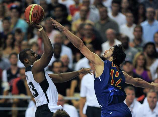 Spain's Sergio Llull (R) vies with Chris Paul (L) during the Pre-Olympic friendly basketball match between Spain and USA at Palau Sant Jordi in Barcelona on July 24, 2012.  AFP PHOTO / LLUIS GENELLUIS GENE/AFP/GettyImages Photo: LLUIS GENE, AFP/Getty Images / AFP