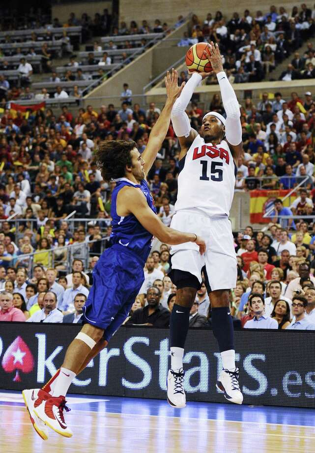 BARCELONA, SPAIN - JULY 24:  Carmelo Anthony #15 of the U.S. Men's Senior National Team shoots against Victor Sada #15 of the Spain Men's Senior National Team during a Pre-Olympic Men's Exhibition Game between USA and Spain at Palau Sant Jordi on July 24, 2012 in Barcelona, Spain. Photo: David Ramos, Getty Images / 2012 Getty Images