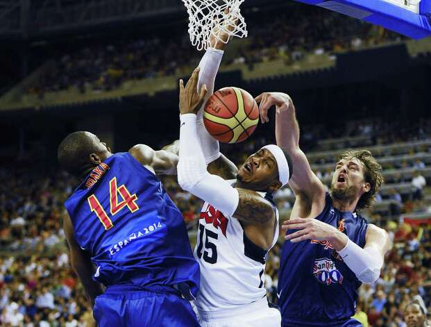 BARCELONA, SPAIN - JULY 24:  Carmelo Anthony #15 of the U.S. Men's Senior National Team duels for the ball with Pau Gasol #4 and Serge Ibaka #14 of the Spain Men's Senior National Team during a Pre-Olympic Men's Exhibition Game between USA and Spain at Palau Sant Jordi on July 24, 2012 in Barcelona, Spain. Photo: David Ramos, Getty Images / 2012 Getty Images