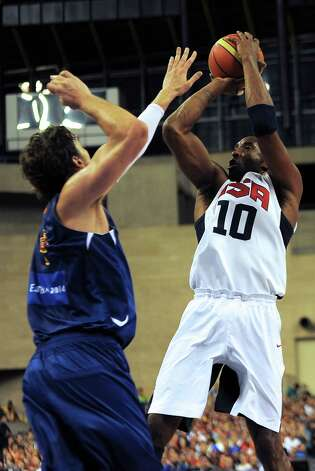 Spain's Pau Gasol (L) vies with Kobe Bryant (R) during the Pre-Olympic friendly basketball match between Spain and USA at Palau Sant Jordi in Barcelona on July 24, 2012.  AFP PHOTO / LLUIS GENELLUIS GENE/AFP/GettyImages Photo: LLUIS GENE, AFP/Getty Images / AFP