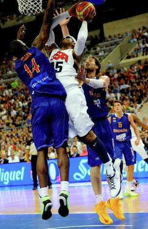 Carmelo Anthony, center, of the US Men's Senior National Team, left, dives for the ball against Pau Gasolof the Spain Men's Senior National Team, right, and Serge Ibaka during an exhibition match between Spain and the United States Tuesday, July 24, 2012, in Barcelona, Spain, in preparation for the 2012 Summer Olympics. (AP Photo/Manu Fernandez) Photo: Manu Fernandez, Associated Press / AP