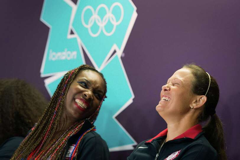 Liezel Huber of Houston, right, laughs with Venus Williams during a news conference by the US tennis