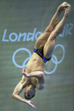 Diver Troy Dumais of Austin trains at the aquatic center before the start of the 2012 Summer Olympics on Tuesday, July 24, 2012, in London. London makes the fourth Olympics for Dumais, a former Texas Longhorn, who joins Greg Louganis as the only U.S. male divers to make four Olympic teams. Photo: Smiley N. Pool, Houston Chronicle / © 2012  Houston Chronicle