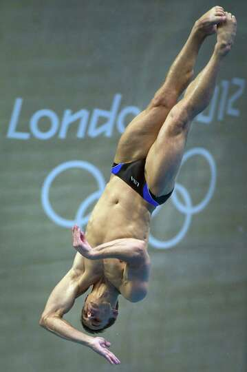 Diver Troy Dumais of Austin trains at the aquatic center before the start of the 2012 Summer Olympic