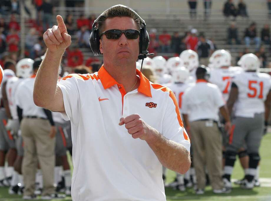 Mike Gundy is 59-30 in seven seasons as the head coach at Oklahoma State. Photo: Associated Press File Photo
