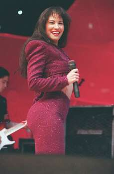 Tejano singer Selena performs at the Astrodome during the Houston Livestock Show and Rodeo.  Selena Quintanilla Perez.  Photo: John Everett / Houston Chronicle