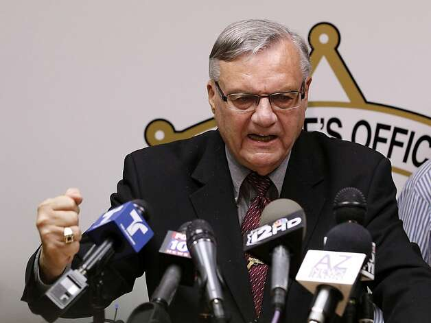 FILE - In this May 10, 2012 file photo, Maricopa County Sheriff Joe Arpaio pounds his fist on the podium during a news conference in Phoenix as he answers questions regarding the Department of Justice's federal civil lawsuit against him and his department. Arpaio, known nationally for his hardline stance on illegal immigration, is expected to take the witness stand Tuesday, July 24, 2012 and face allegations that his trademark immigration sweeps amounted to racial profiling against Hispanics. (AP Photo/Ross D. Franklin, File) Photo: Ross D. Franklin, Associated Press