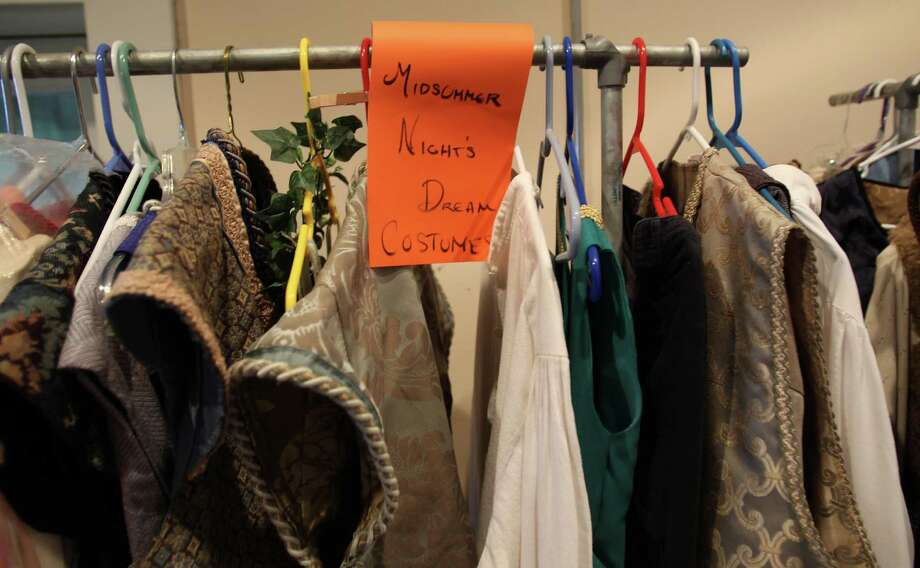 Costumes, all made by students, hang in the costume shop. Photo: Karen Warren, Houston Chronicle / © 2012  Houston Chronicle