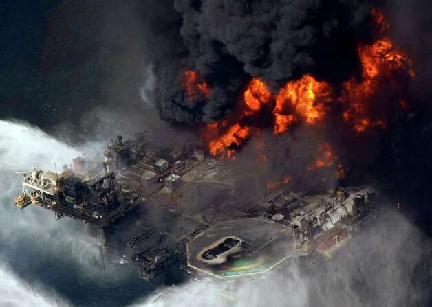 In an April 21, 2010 file aerial photo taken in the Gulf of Mexico more than 50 miles southeast of Venice, La., the Deepwater Horizon oil rig is seen burning.   BP focused too much on the little details of personal worker safety instead of the big systemic hazards that led to the 2010 Gulf of Mexico oil spill  the U.S. Chemical Safety Board concluded in a presentation to be made in a hearing in Houston Tuesday July 24, 2012. Photo: AP
