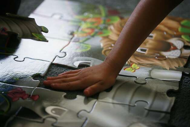Alyson Diaz, 5, works on a puzzle at the Mission Head Start program on Tuesday July 24, 2012 in San Francisco, Calif.  A new study that shows California has fallen from 16th to 41st in the country when it comes to children's well-being. The rankings take into account economic well-being, education, health, and family and community. Photo: Mike Kepka, The Chronicle