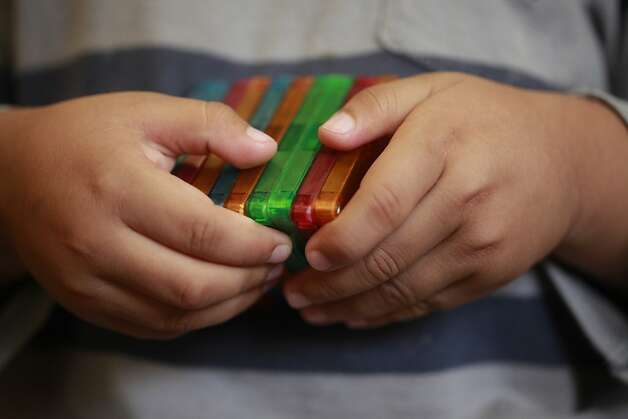 Diego Careta, 3, figures out how to a set of magnetic building blocks at the Mission Head Start program on Tuesday July 24, 2012 in San Francisco, Calif.  A new study that shows California has fallen from 16th to 41st in the country when it comes to children's well-being. The rankings take into account economic well-being, education, health, and family and community. Photo: Mike Kepka, The Chronicle