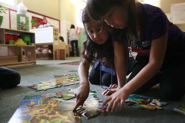 Jasmin Gavajal, 5, and Alyson Diaz, 5, work on a puzzle together at the Mission Head Start program on Tuesday July 24, 2012 in San Francisco, Calif.  A new study that shows California has fallen from 16th to 41st in the country when it comes to children's well-being. The rankings take into account economic well-being, education, health, and family and community. Photo: Mike Kepka, The Chronicle