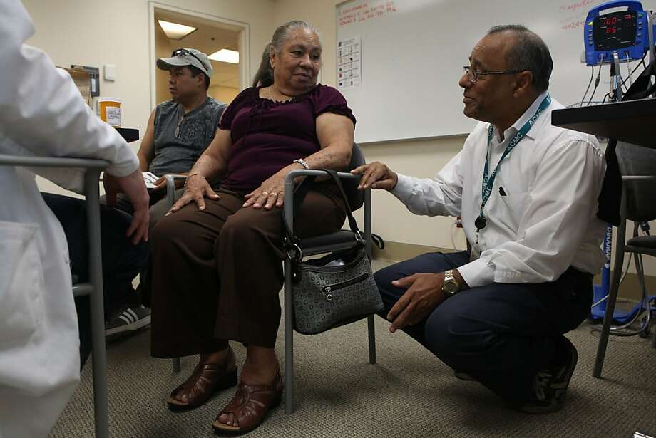 Concepcion Ramirez Mejia, 74, talking with specialists at the Fall Prevention Clinic at Highland Hospital in Oakland on Monday. Photo: Liz Hafalia, The Chronicle