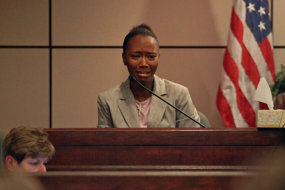 Defendant Tiffany James, 20, breaks down in tears as she testifies in her murder trial for the death of Antwan Wolford, the father of her child and her boyfriend at the time, in the Bexar County 399th District Court on Tuesday, July 24, 2012. Photo: Lisa Krantz, San Antonio Express-News / SAN ANTONIO EXPRESS-NEWS