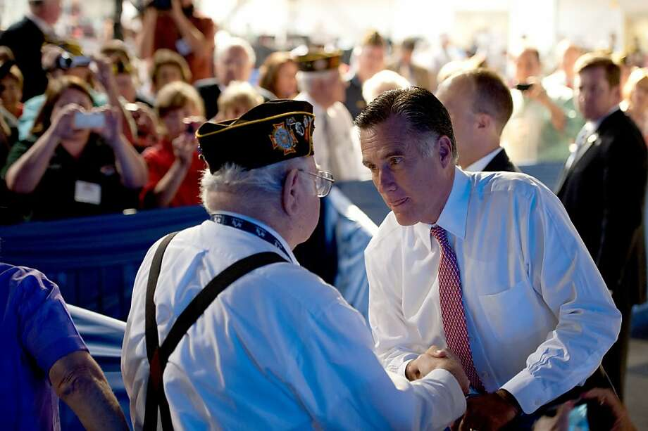 Jim Thone of Bakersfield, California, meets Republican presidential candidate Mitt Romney during the VFW convention at the Reno-Sparks Convention Center in Reno, Nevada, Tuesday, July 24, 2012. (Jose Luis Villegas/Sacramento Bee/MCT) Photo: Jose Luis Villegas, McClatchy-Tribune News Service