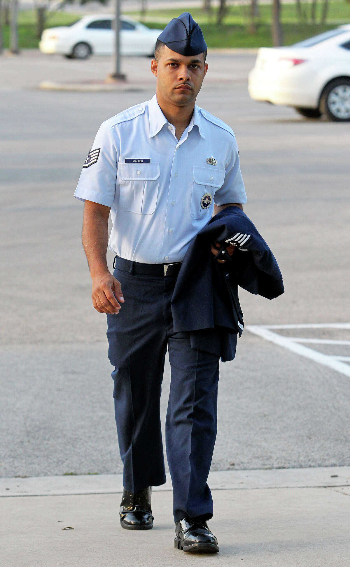 Air Force Sgt. Luis Walker enters the 37th Training Wing Headquarters for sentencing on July 21, 2012.