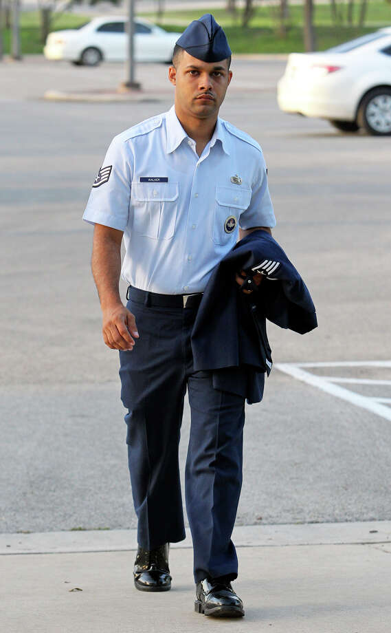 Air Force Sgt. Luis Walker enters the 37th Training Wing Headquarters for sentencing on July 21, 2012. Photo: Tom Reel, San Antonio Express-News / ©2012 San Antono Express-News