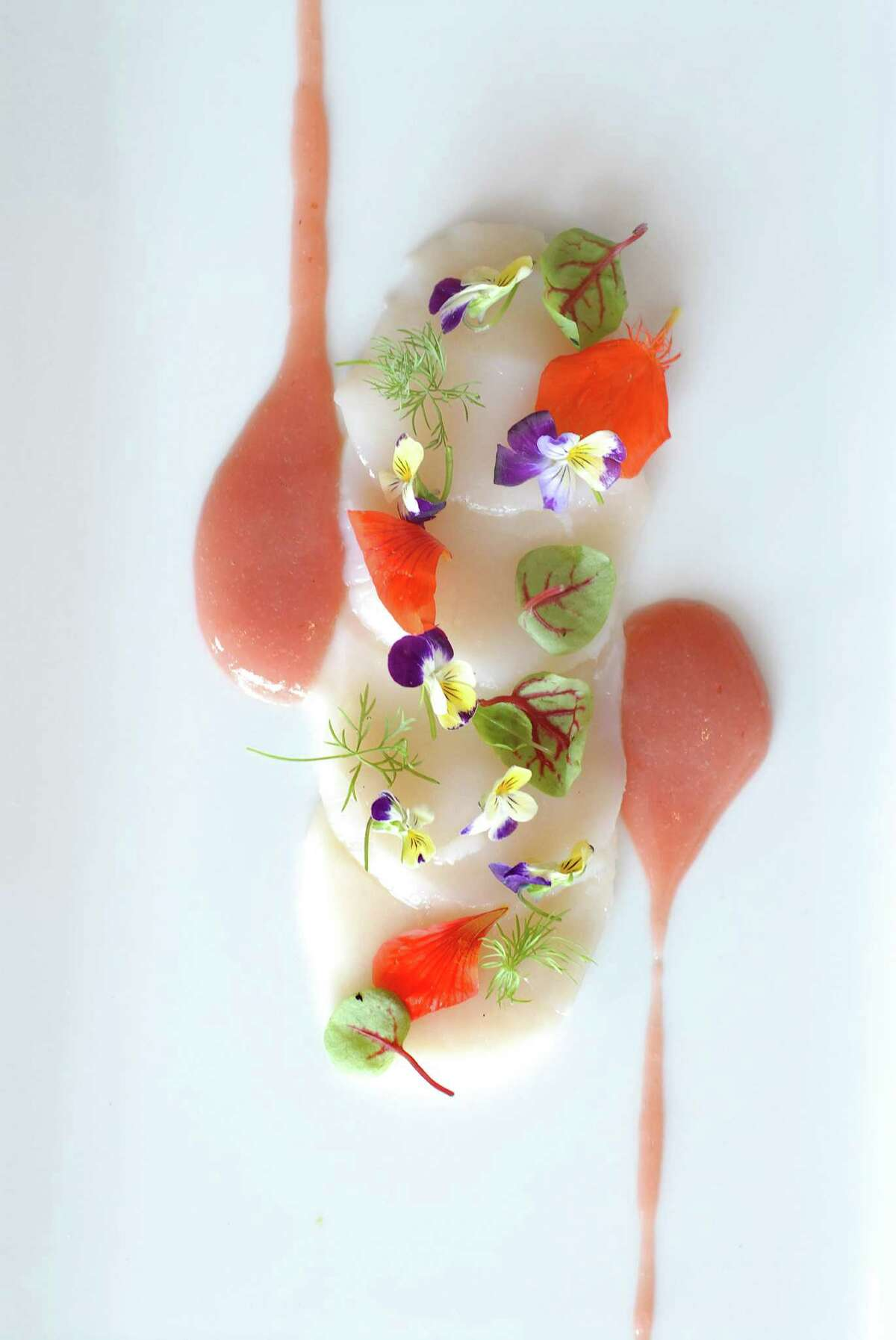 Crudo of Maine sea scallops with yuzo vinaigrette, radish flowers, rhubarb at Elm restaurant in New Canaan, Conn. Solé and Elm Part of Z Hospitality Group, which owns Mediterraneo and East End in Greenwich and Terra of Greenwich and Danbury, Solé, is one of Tropeano's picks for dining in town. She also recommends Elm downtown.