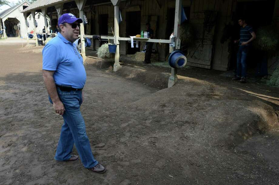 Martin Schwartz walks the barn area of trainer Chad Brown at the Oklahoma Training Center in Saratoga Springs, N.Y. this morning July 23, 2012,  (Skip Dickstein / Times Union) Photo: SKIP DICKSTEIN