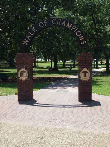 The famed Walk of Champions marks the entrance to the beautiful Grove on the campus of Ole Miss in Oxford, Mississippi. Photo: Forrest Jividen , For The Express-News