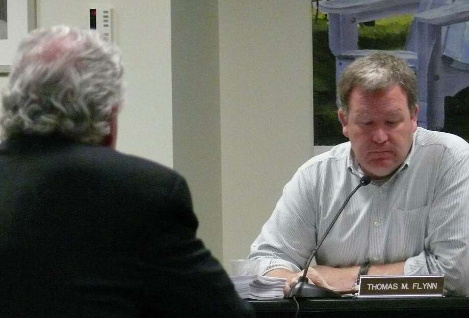 First Selectman Mike Tetreau, with his back to the camera, declined to comment on the employment status of Fiscal Office Paul Hiller at Tuesday's Board of Finance meeting. Chairman Thomas Flynn said Hiller remains the board's clerk. Photo: Genevieve Reilly / Fairfield Citizen