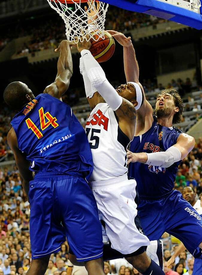 Carmelo Anthony of the US Men's Senior National Team, center, competes for the ball against Serge Ibaka of the Spain Men's Senior National Team, left, and Pau Gasol during an exhibition match between Spain and the United States Tuesday, July 24, 2012, in Barcelona, Spain, in preparation for the 2012 Summer Olympics. (AP Photo/Manu Fernandez) Photo: Manu Fernandez, Associated Press