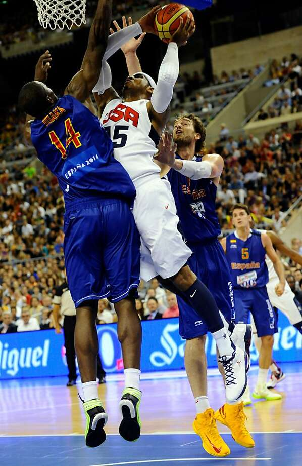 Carmelo Anthony, center, of the US Men's Senior National Team, left, dives for the ball against Pau Gasolof the Spain Men's Senior National Team, right, and Serge Ibakaduring an exhibition match between Spain and the United States Tuesday, July 24, 2012, in Barcelona, Spain, in preparation for the 2012 Summer Olympics. (AP Photo/Manu Fernandez) Photo: Manu Fernandez, Associated Press