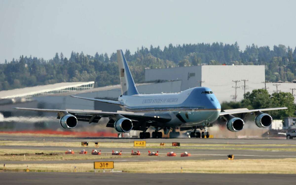 Air Force One touches down at King County International Airport on Tuesday, July 24, 2012. Obama is in town for the third time this year to raise money at two private fundraising events and will stay overnight in Bellevue before departing Wednesday morning. The two events, one at former Costco CEO Jim Sinegal's house, the other a larger reception of about 200, are expected to contribute around $1.75 million towards Obama's re-election campaign.