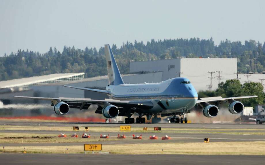 Air Force One touches down at King County International Airport on Tuesday, July 24, 2012. Obama is in town for the third time this year to raise money at two private fundraising events and will stay overnight in Bellevue before departing Wednesday morning. The two events, one at former Costco CEO Jim Sinegal's house, the other a larger reception of about 200, are expected to contribute around $1.75 million towards Obama's re-election campaign. Photo: LINDSEY WASSON / SEATTLEPI.COM