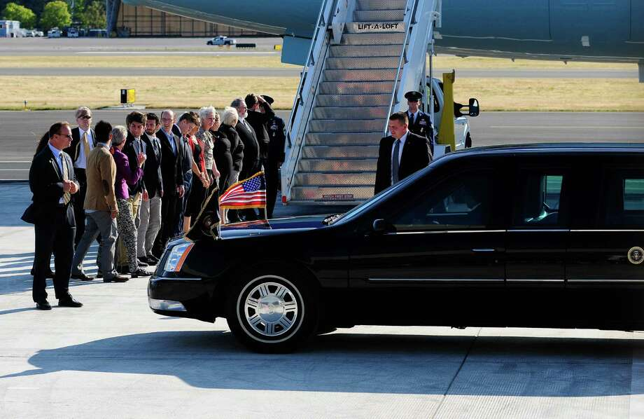 A Presidential limo drives up to the stairs as people wait to greet President Obama in front of Air Force One at King County International Airport on Tuesday, July 24, 2012. Obama is in town for the third time this year to raise money at two private fundraising events and will stay overnight in Bellevue before departing Wednesday morning. The two events, one at former Costco CEO Jim Sinegal's house, the other a larger reception of about 200, are expected to contribute around $1.75 million towards Obama's re-election campaign. Photo: LINDSEY WASSON / SEATTLEPI.COM