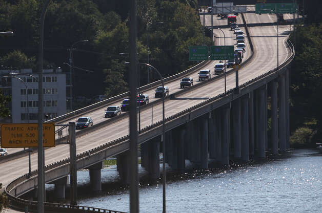 The motorcade of U.S. President Barack Obama drives onto State Route 520 toward a fundraiser at the home of Costco co-founder Jim Sinegal. The President was in Seattle for a visit to raise money for his campaign. The Washington State Department of Transportation said on Twitter that the motorcade would be required to pay the toll on the highway. Photo: JOSHUA TRUJILLO / SEATTLEPI.COM