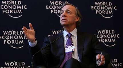 """Raymond """"Ray"""" Dalio, president and founder of Bridgewater Associates LP, right, speaks while Vikram Pandit, chief executive officer of Citigroup Inc., listens during a press conference on day one of the World Economic Forum (WEF) in Davos, Switzerland, on Wednesday, Jan. 25, 2012. The 42nd annual meeting of the World Economic Forum will be attended by about 2,600 political, business and financial leaders at the five-day conference. Photographer: Chris Ratcliffe/Bloomberg *** Local Caption *** Ray Dalio; Vikram Pandit"""