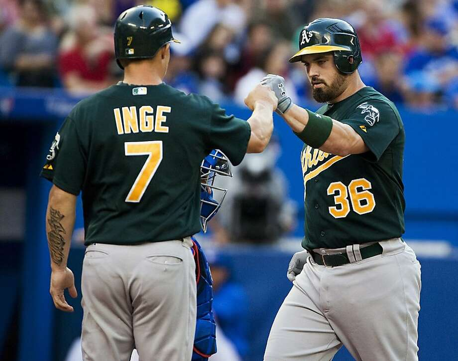 Oakland Athletics' Derek Norris, right, celebrates a two run home run with Brandon Inge against the Toronto Blue Jays during the second inning of a baseball game,Tuesday, July 24, 2012, in Toronto. (AP Photo/The Canadian Press, Aaron Vincent Elkaim) Photo: Aaron Vincent Elkaim, Associated Press