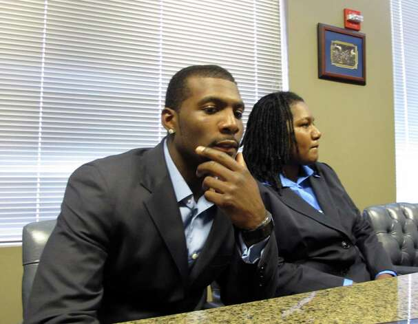 Dallas Cowboys wide receiver  Dez Bryant sits next to his mother, Angela Bryant, during a news conference in Dallas, Tuesday, July 24, 2012. Authorities say Angela Bryant called 911 after a July 14 incident in which her son hit her with a hat and grabbed her shirt, causing it to tear. Dez Bryant was arrested two days later. Photo: AP