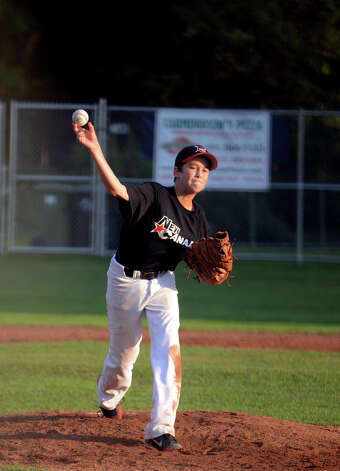 New Canaan's Dillon Abate (10) pitches during the Cal Ripken New England Regional Tournament between New Canaan and Newtown at Glander Field in Newtown on Tuesday, July 24, 2012. Photo: Amy Mortensen / Connecticut Post Freelance