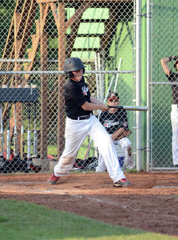 New Canaan's Matt Burger (9) hits a home run during the Cal Ripken New England Regional Tournament between New Canaan and Newtown at Glander Field in Newtown on Tuesday, July 24, 2012. Photo: Amy Mortensen / Connecticut Post Freelance