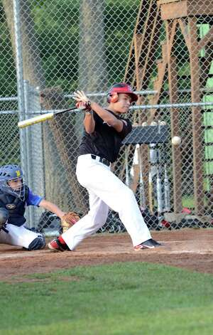 New Canaan's Rob Jones (15) at bat during the Cal Ripken New England Regional Tournament between New Canaan and Newtown at Glander Field in Newtown on Tuesday, July 24, 2012. Photo: Amy Mortensen / Connecticut Post Freelance