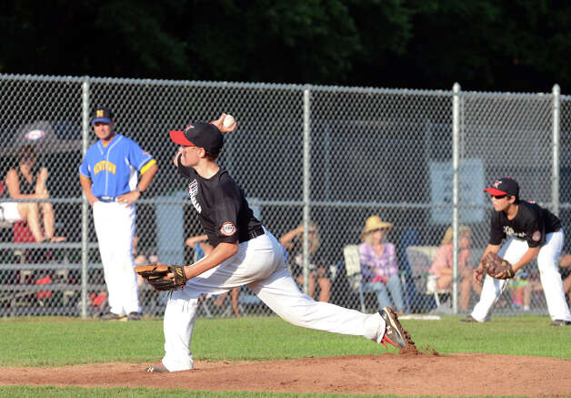 New Canaan's Matt Burger (9) pitches during the Cal Ripken New England Regional Tournament between New Canaan and Newtown at Glander Field in Newtown on Tuesday, July 24, 2012. Photo: Amy Mortensen / Connecticut Post Freelance