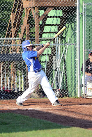 Newtown's Lucas O'Brien (13) at bat during the Cal Ripken New England Regional Tournament between New Canaan and Newtown at Glander Field in Newtown on Tuesday, July 24, 2012. Photo: Amy Mortensen / Connecticut Post Freelance