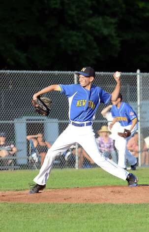 Newtown's Jason Hebner (42) pitches during the Cal Ripken New England Regional Tournament between New Canaan and Newtown at Glander Field in Newtown on Tuesday, July 24, 2012. Photo: Amy Mortensen / Connecticut Post Freelance