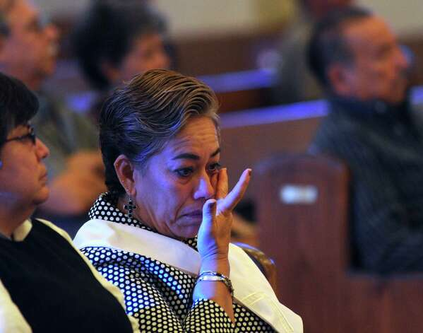 Socorro Davila wipes away a tear during a Mass said at Capilla de la Santa Trinidad in Victoria on Tuesday, July 24, 2012, for the 15 immigrants that died as a result of a horrific wreck in Goliad County on Sunday. Photo: Billy Calzada, San Antonio Express-News / © 2012 San Antonio Express-News